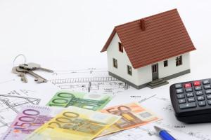 Welche Vorteile bringt eine Baukredit-Umschuldung mit sich?