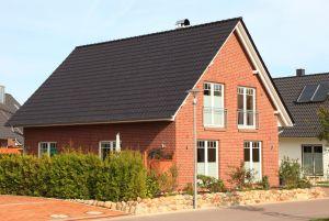 Bild: A Young Family Bauweise: Bau vor Ort, traditioneller Hausbau Bauart: Massivhaus, Ziegelsteine
